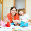 Happy mother and her children — Stockfoto