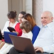 Multigenerations family with electronic devices — Stock Photo