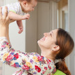 Happy mother holds little baby   — Stock Photo