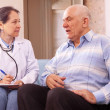 Mature man complaining to doctor about feels — Stock Photo