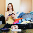 Woman packing documents into suitcases   — ストック写真