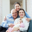 happy mature couple with daughter and granddaughter  — Stock Photo