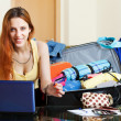 Female tourist buying tickets  online — Stock Photo
