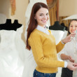 Stock Photo: Happy women chooses bridal outfit