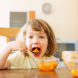 Little girl eating carrot salad   — Stock Photo