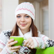 Stock Photo: Girl warms with cup of at house