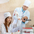 Stock Photo: Nurse and doctor works in clinic lab