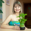 Girl with lucky bamboo   — Stock Photo #32306313