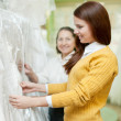 Women chooses wedding outfit — ストック写真