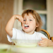 Child eats with spoon   — Stock Photo
