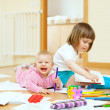sibling plays with pencils   — Stock Photo