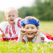 Two children in traditional clothes — Stock Photo