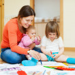Happy mother with  children plays at home — Stock Photo