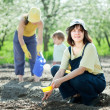 Women with child works at vegetables garden — Stock Photo #32306657