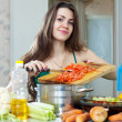 Stock Photo: Housewife cooking veggie lunch with vegetables