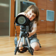 Child takes photo with tripod — Stock Photo