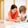 Mother and her child sketching on paper — Stock Photo