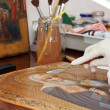 Stock Photo: Restoration of old icon with palette knife