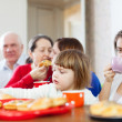 Family communicate around tea table — Stock Photo