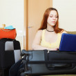 Woman reserving hotel online in internet — ストック写真