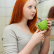 Teenager gargling throat in bathroom — Stock Photo #32307405
