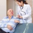 Senior man tells the doctor the symptoms — Stock Photo