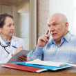 Stock Photo: Womdoctor and senior patient