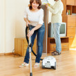 Stock Photo: Happy woman and man doing housework