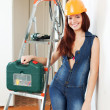 Stock Photo: Sexy woman in hardhat with tools
