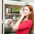 Stock Photo: Womholding foul food