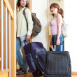 Couple with suitcases near door at home — Stock Photo