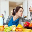Stock Photo: Young woman tests food