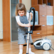 Girl with vacuum cleaner — Stock Photo