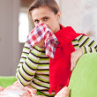 Stock Photo: Illness womuses handkerchief
