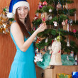 Girl near decoration spruce — Stock Photo #32308223