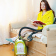 Woman reposes from household chores — Stock Photo