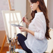 Stock Photo: Artist near blank canvas