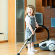 2 years girl with vacuum cleaner — Stock Photo