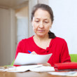 Woman fills in payment documents — Stock Photo