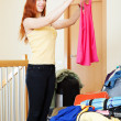 Woman choosing clothes for vacation   — Stock Photo