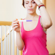 Sad serious  woman with pregnancy test — Stock Photo
