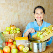 Woman cooks apple jam — Stock Photo