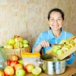 Woman cooks apple jam — Stock Photo