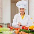 Cook works at kitchen — Stock Photo
