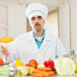 Cook cooking  in kitchen — Stock Photo