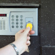 Uses intercom in steel door — Stock Photo