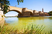 Puente de Piedra at Zaragoza in sunny day — Stock Photo