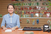 Saleswoman at shop for gardener — Stock Photo