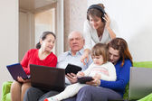 Family of with few various portable computers — Stock Photo