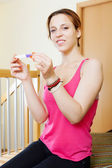 Girl with pregnancy test — Stock Photo